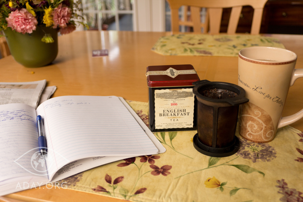 a cup of tea and a composition notebook.  A Day 6-15-2012